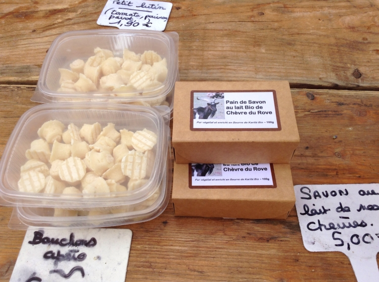 Cheese stand at Sault market with Bouchons Apero and Savon